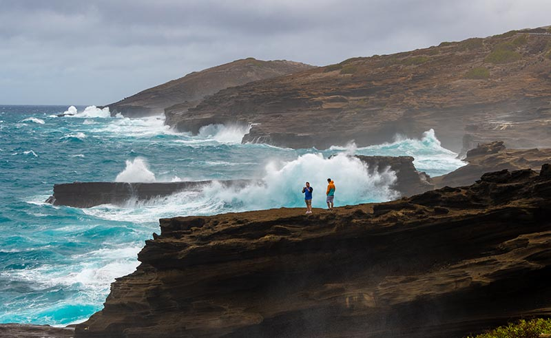 Giant surf generated by a hurricane pounds the cliffs on Oahu's east shore.