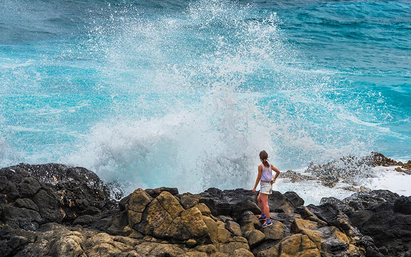 Rogue waves can unexpectedly knock a person into the water and cause serious injury. Phillip B. Espinasse/Shutterstock.com